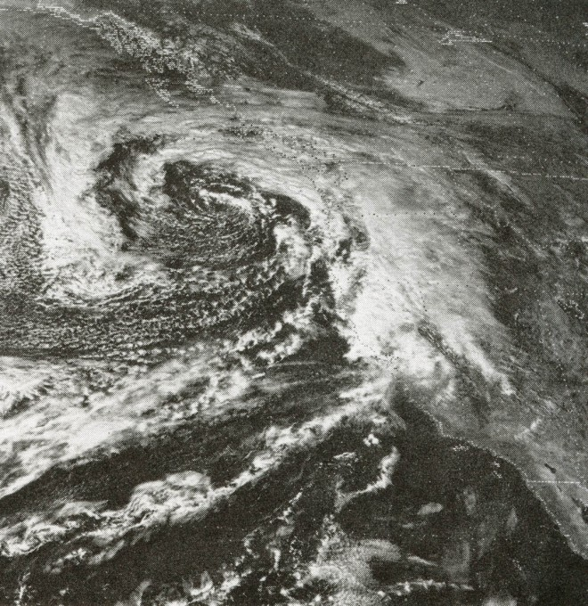 A winter storm which originated off the coast of Japan and has traveled westward across the Pacific in a great arc arrives in the Northwest and is deflected towards California by the Cascade Mountains and the Sierra Nevada. Satellite photograph supplied by U.S. Weather Bureau.