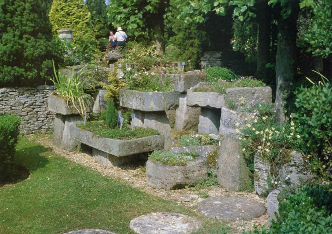 Collection of stone troughs at Rodmarton Manor, Gloucestershire. Photograph by George Waters