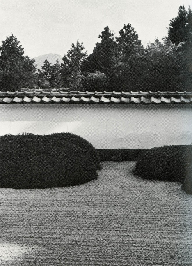 """Clipped shrubs, here arranged in clusters of odd numbers, substitute for rocks in this dry garden. In the background is Mt. Hiei, """"borrowed"""" into the garden view. Shoden-ji, Kyoto"""