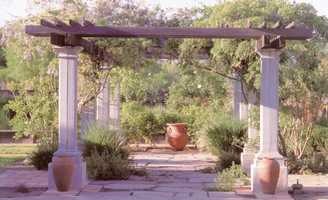 A wisteria (Wisteria sinensis) tops the second section of the grand pergola, between the pool and the orchard and kitchen garden