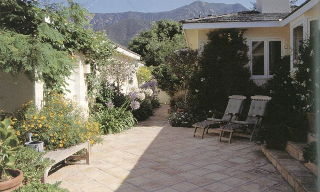 A contemporary interpretation of a Mediterranean courtyard garden, enclosed with walls, paved to save water, furnished for livability, and planted to provide color without excessive water. (Nancy Goslee Power garden, Santa Barbara)