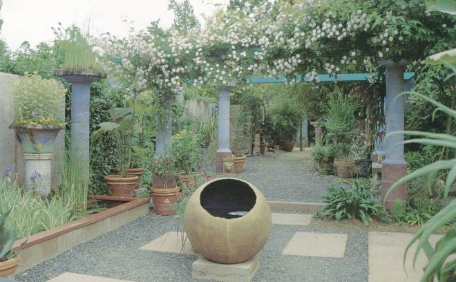The entry court of Little and Lewis. The sphere in the foreground is thirty inches in diameter and faces south. The midday sun strikes the surface of the water inside, creating waves of light on the dark inner surface. Paul's Himalayan rose clambers over the blue Doric Pergola in the background. Photographs by Little and Lewis