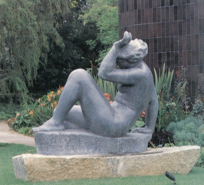 Aristide Maillol's La Montagne (1937) with the bright colors of the summer garden beyond