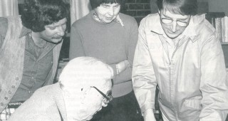 (standing) Laurence Hyman, Margedant Hayakawa, and George Waters, and (seated) Owen Pearce examining the blue-line proof of the first issue of Pacific Horticulture, December, 1975. Photograph by Olive Rice Waters
