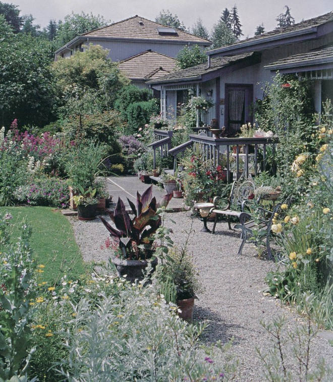 A graveled terrace next to the house provides space for container plantings and seating, from which to view the rear garden. Photograph by RGT