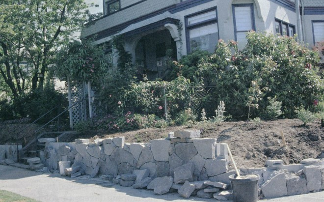 At the Hardiman residence, the stone wall under construction at the sidewalk's edge eliminated a steep bank and created a bed for planting a streetside garden. Photographs by Lucy Hardiman, except as noted