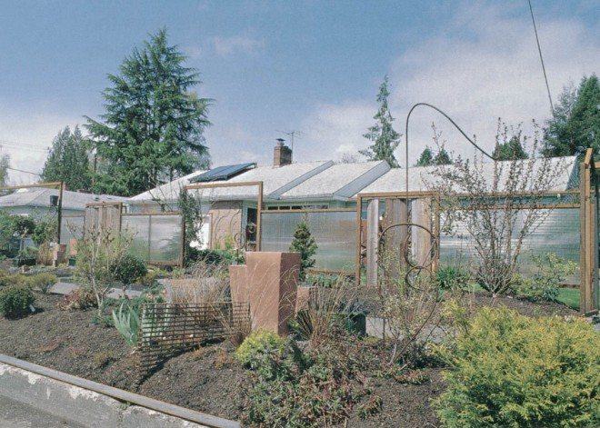 First-year construction and plantings at the Crockett residence; note the variation in fence panels allowing full or minimal visual access to the enclosed front garden. Photograph by Coleston Burrell