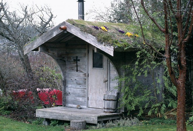 Anne built the cedar sauna house after enjoying one on a fishing trip to Alaska. She cut sod from the lawn and hefted it to the roof, planting crocuses and other tiny bulbs in the grass. As a result, the structure softly blends into the landscape.
