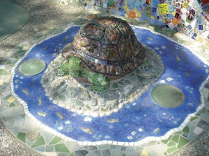 A mosaic turtle, part of a whimsical children's garden sculpture by Colleen Barry