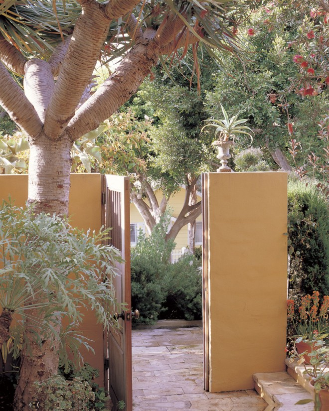 A simple gateway opens to the front courtyard of Nancy Goslee Power's Santa Monica garden. Photographs by John M Hall