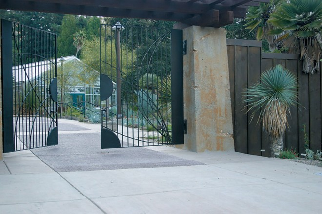 The view through UCBG's new gate to the Entry Garden and the Arid Greenhouse beyond