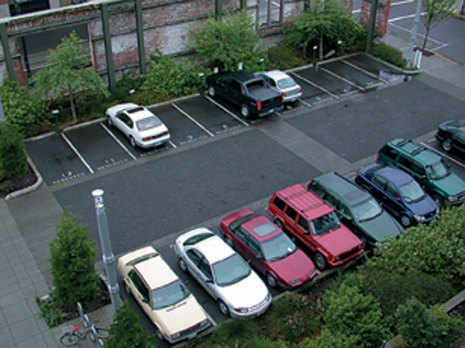 A parking lot at the EcoTrust Building in Portland, Oregon, where petroleumpolluted rainwater drains into adjacent sunken beds planted with native trees and shrubs; there, it is filtered and allowed to replenish the groundwater