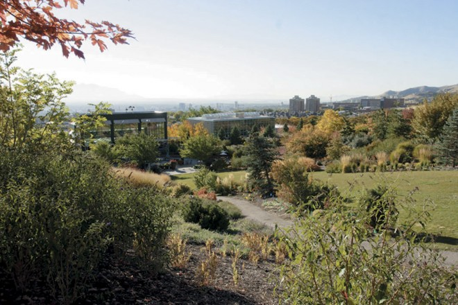From a high point in the Four Seasons Garden, visitors can look back on the Visitor's Center and the distant skyline of Salt Lake City