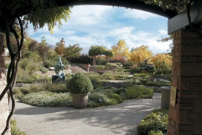 An entrance arbor frames the view into the Herb Garden