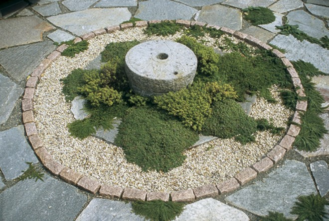 Creeping thymes (Thymus species) surround the millstone in the center of the circular terrace - See more at: http://www.pacifichorticulture.org/articles/a-mediterranean-garden-in-seattle/#sthash.BkMnmHyE.dpuf