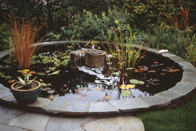 A fragment from the Music Hall Theater makes a spiral watercourse for a fountain in the center of the stone rimmed pool - See more at: http://www.pacifichorticulture.org/articles/a-mediterranean-garden-in-seattle/#sthash.BkMnmHyE.dpuf