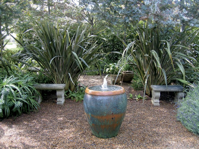 Bold plantings of New Zealand flax (Phormium) and aloes frame a small gathering space in a Santa Monica garden by landscape architect Joseph Marek. Photograph by Joseph Marek