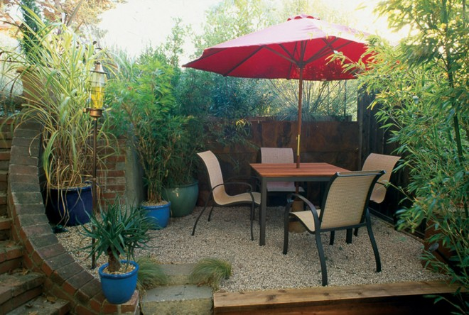 A small dining terrace below the garden