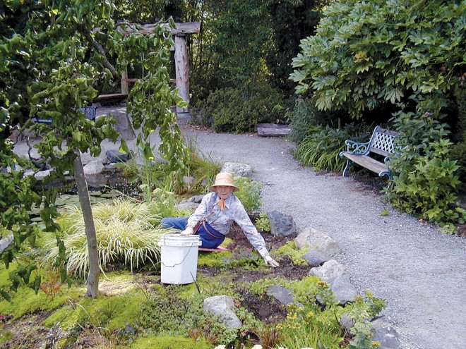 Elda Behm volunteering in her new garden at the Highline SeaTac Botanical Garden