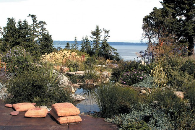 View across a terrace and pools to the garden and Puget Sound beyond