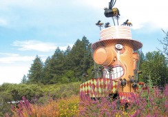 A giant beekeeper, by Patrick Amiot of Sebastopol, California, is a focal point of the Melissa Garden