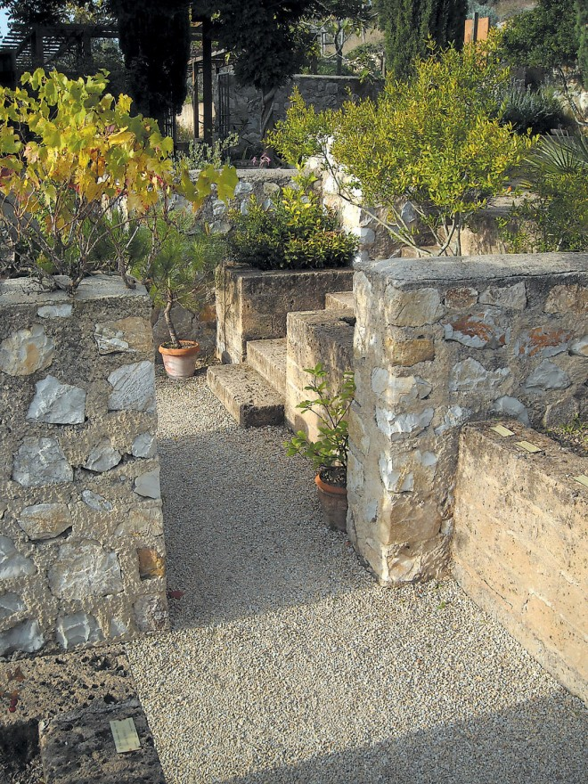 "Modern walls of ancient stone define several of the ""rooms,"" including il Labirinto, where medicinal plants are grown"