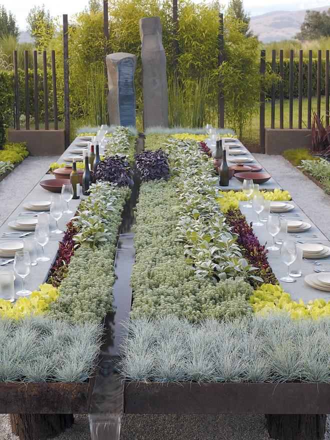 The Future Feast table showing green roof plantings with organic edibles surrounding the bluestone place settings; basalt sculpture in the rear by Suzanne Biaggi