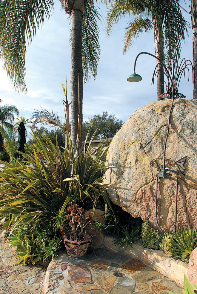 An outdoor shower, screened from the home and dining terrace by large boulders. Photograph by Dawn Lohnas