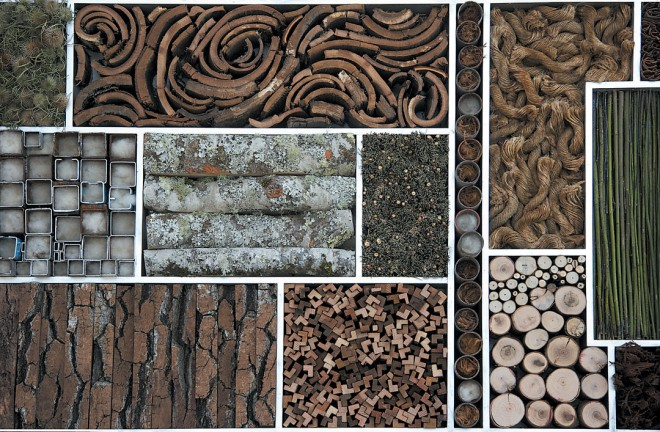 Art as habitat: a bug-hotel panel of bark, twigs, and other materials set in a metal frame, to be hung on a wall. Design and photograph by Caitlin Atkinson