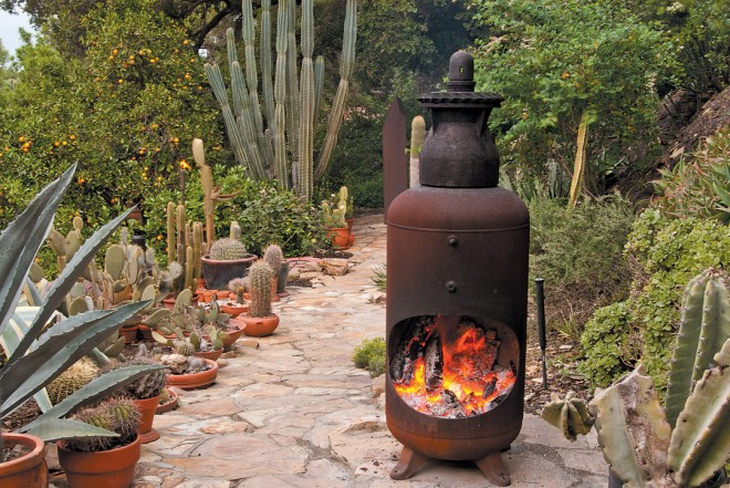 Main path view from patio to the largest of three chiminea flanked by succulents