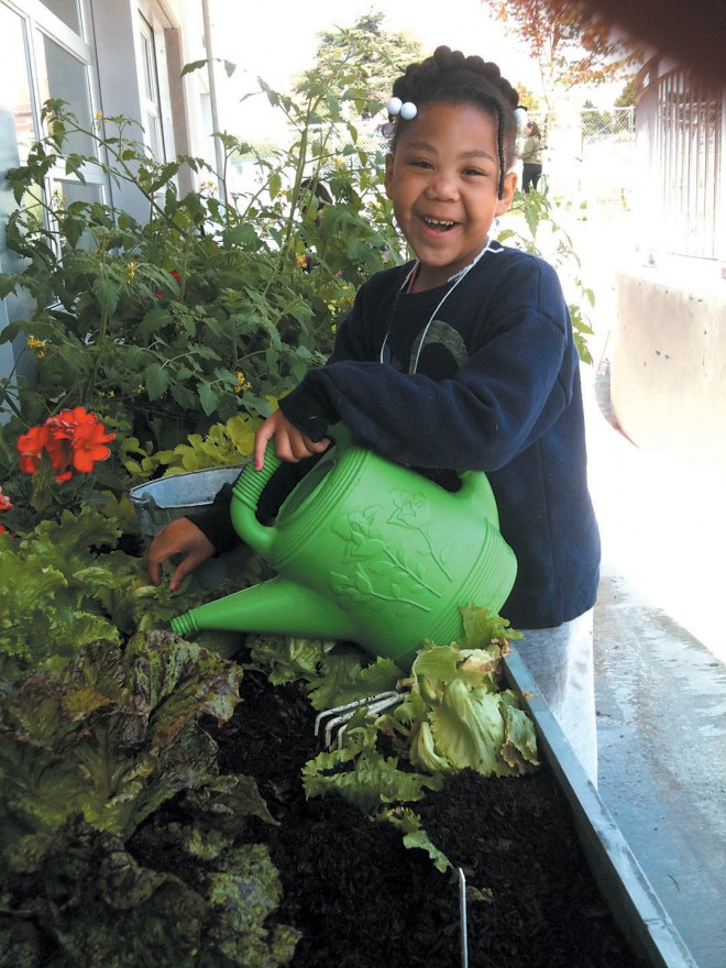 An enthusiastic young gardener at the Seattle Children's PlayGarden