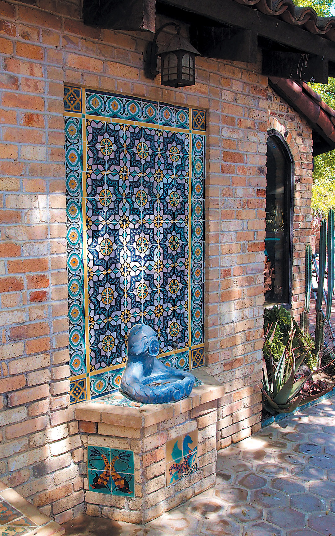 Tile And Recycled Yellow Brick Set Off A Lovely Drinking Fountain With A  Mythical Sea Creature