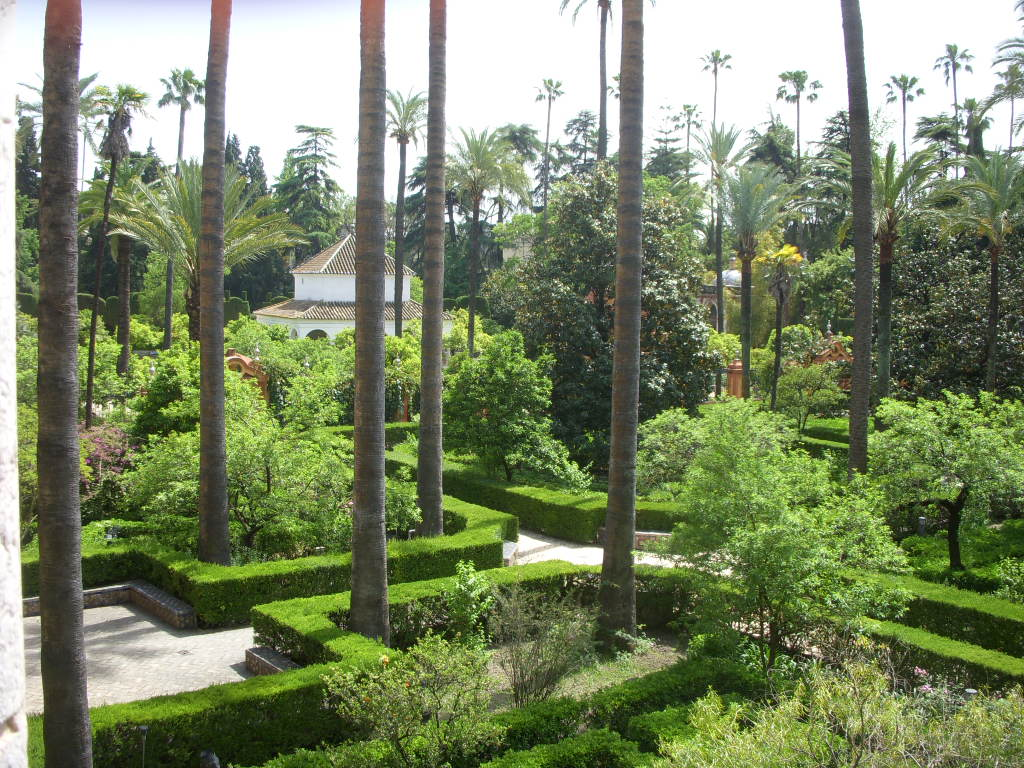 Tidy hedges contain lush plantings in the gardens at the Alcazar.