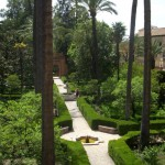 Lush plantings contrast with the formal design, Alcazar.