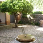 A bubbling fountain and the shade of trees help cool this Alhambra courtyard.