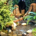 """A River Runs Through It"" Created by: Evergreen Landscaping and Ponds Further theatrics: a convincingly naturalistic water feature was the star of this small slice of the woods. Plenty of ""wildlife"" but no Redford..."