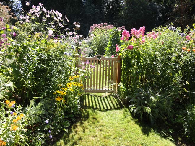 Julie O'Donald's late-summer garden burgeons with pollinator-friendly flowering perennials. Photo: Megan O'Donald