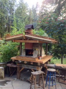Wocka's wood-fired oven gets it's own green roof furnished with edible herbs. Photo: Warwick Hubber