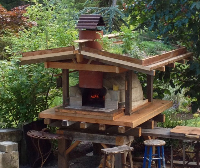 Wocka's wood-fired oven get it's own green roof furnished with edible herbs. Photo: Warwick Hubber