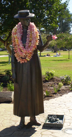 Kate O. Sessions Statue in Balboa Park with commemorative birthday leis from the San Diego Floral Association.