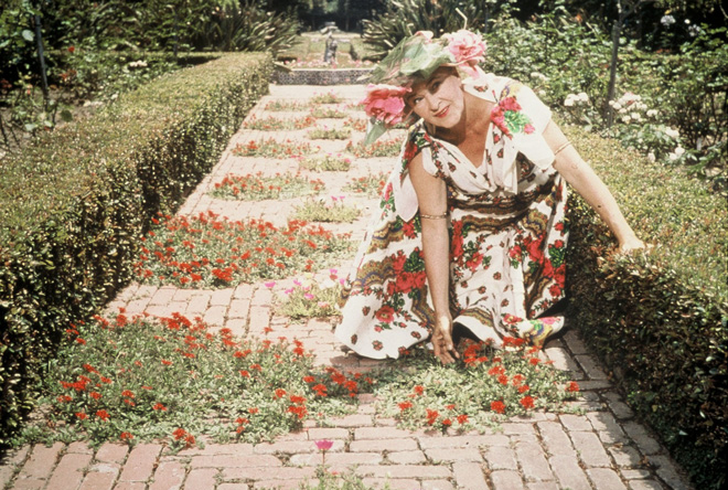 Madame Ganna Walska kneeling in the garden in the late 1950s. Photo: Ganna Walska Lotusland.