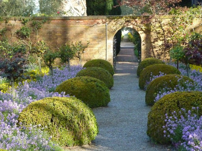 Repeated boxwood spheres at Filoli bring order to the exuberance of the flowering border. Photo: Billy Goodnick