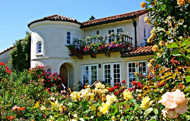 The charming mediterranean-style home at the Russian River Rose Company bedecked with blooms.  Photo: Mikala Kennan