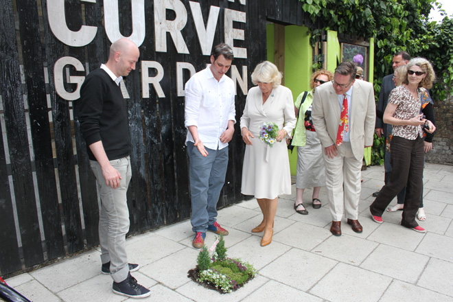 Camilla, Duchess of Cornwall, with The Pothole Gardener at Chelsea Fringe 2012.  