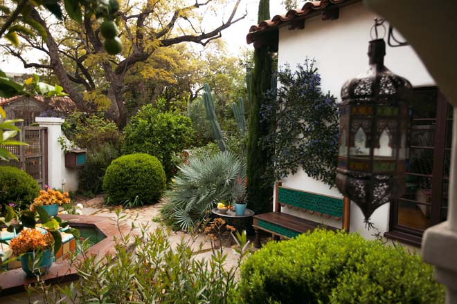 Another view of the front courtyard featuring clipped and wall-trained plants, and the silvery foliage of Chamaeops humilis var. argentea.Photo: Jeff Dunas