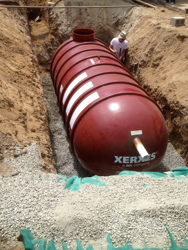 "A 3,000-gallon ""day tank"" that feeds the irrigation system is buried beneath the front drive.  Photo: Paula Henson"