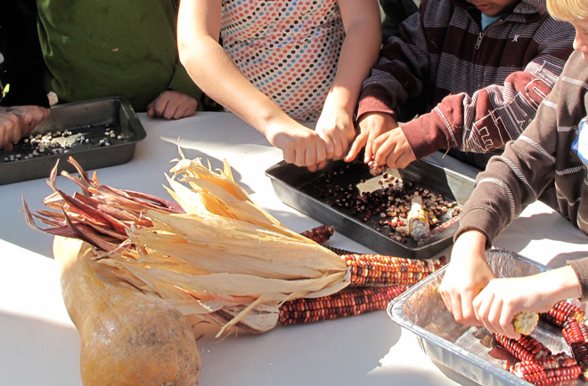 Teaching kids to save seeds. Photo: The Living Seed Company