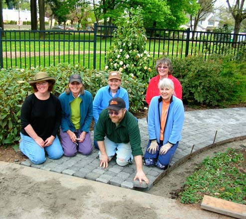 Volunteer board members complete a project at the Portland Memory Garden. Photo: Gary Miranda