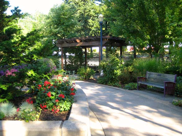 Wide, curved pathways lead to a shady pergola in the Portland Memory Garden. Photo: Patty Cassidy