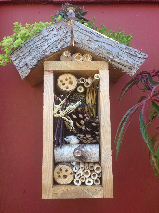 Resourceful gardeners and creative eco-artists are constructing graphic bee houses from backyard bits and pieces like this one in the garden of Wendy Lagozzino. Photo: Lorene Edwards Forkner